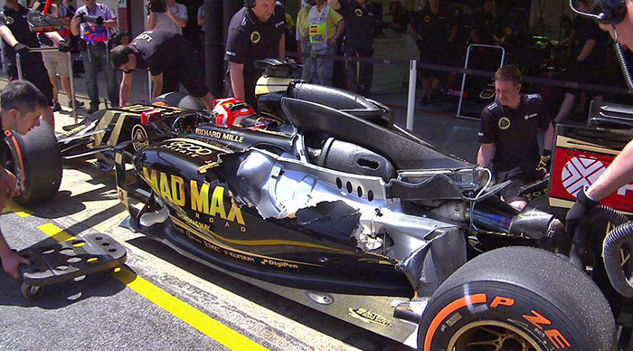 Lotus E23 in the pits at the British GP after bodywork flew off the car