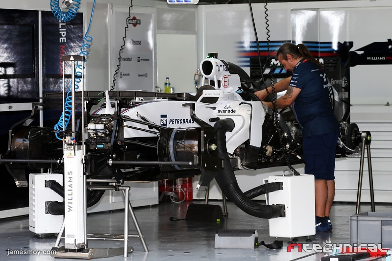 The Williams Fw37 Is Prepared In The Pit Garage