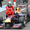 Fernando Alonso gets a ride from Mark Webber