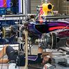 A Red Bull Racing RB10 is prepared in the pits