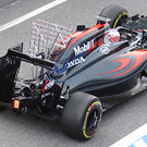 Jenson Button leaves pits in McLaren MP4-31