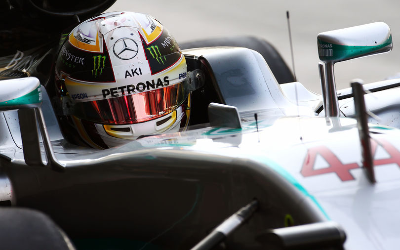 Hamilton seizes pole at Abu Dhabi
