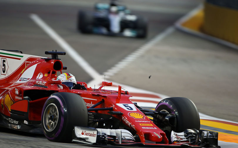 Vettel takes pole position ahead of Red Bull duo in Singapore