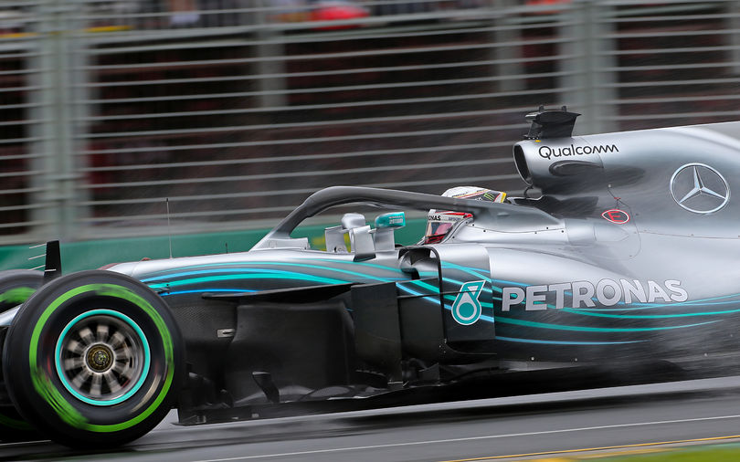 Hamilton leaves Ferrari behind to take Australian pole