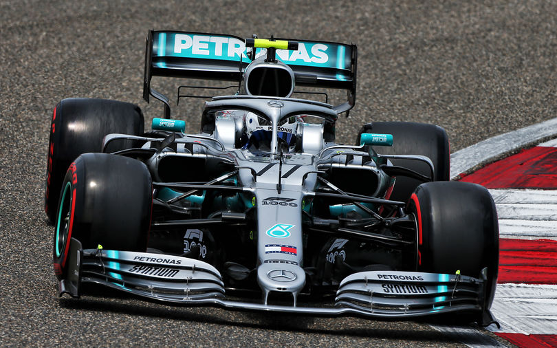 Bottas edges Hamilton to take Chinese pole position