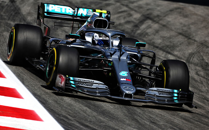 Bottas pips Hamilton for pole position