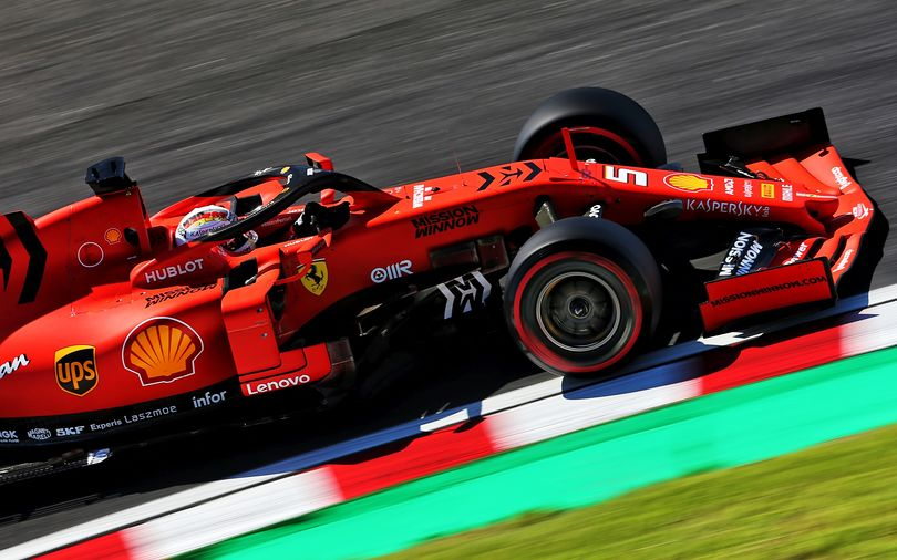 Vettel takes pole in surprising Ferrari front-row lockout